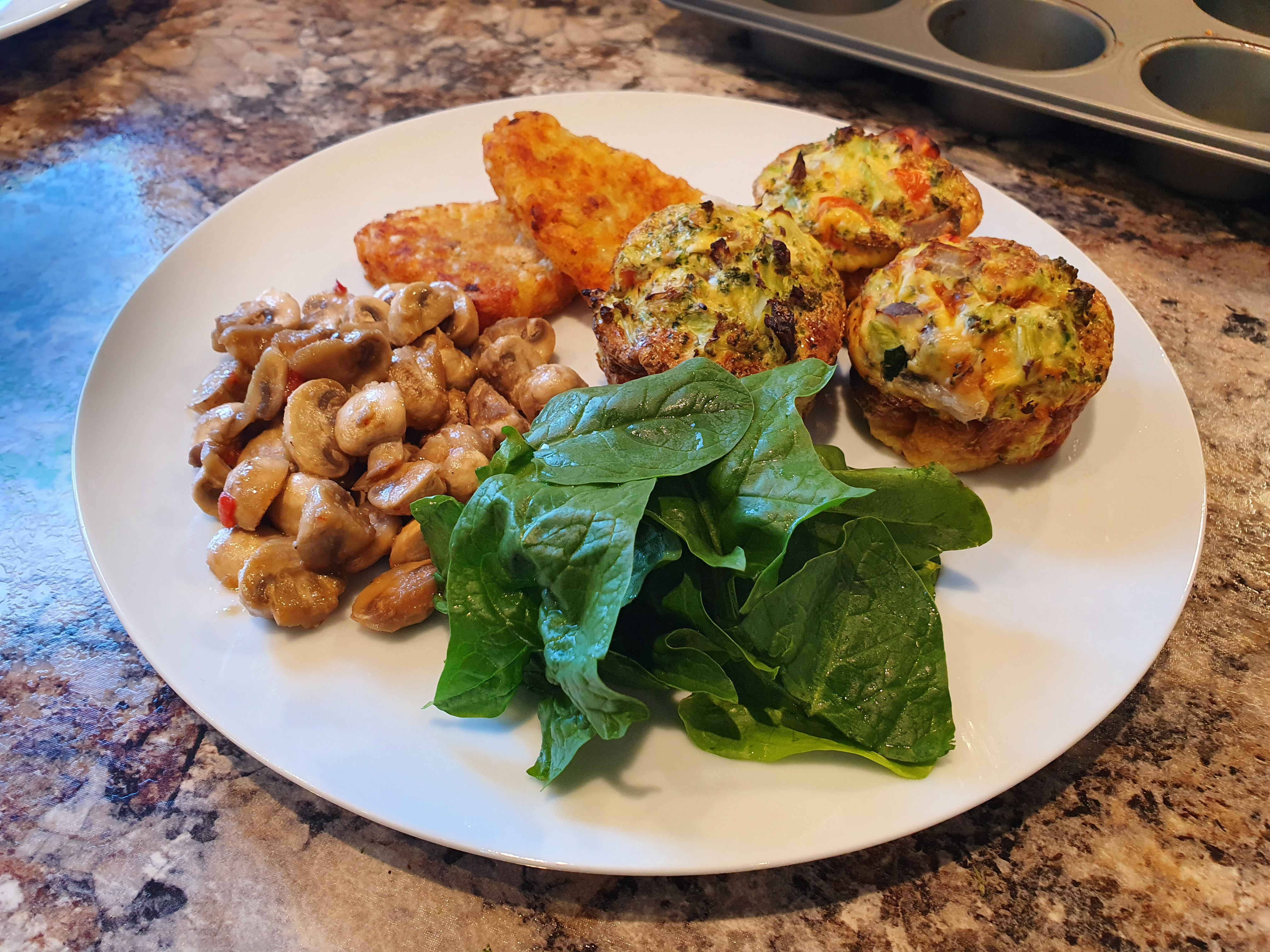 Egg and broccoli muffins baked served with salad